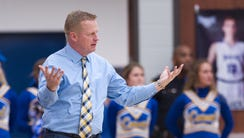Carmel High School head coach Tod Windlan reacts to