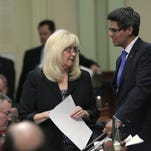 In this 2012 file photo, Assembly Minority Leader Connie Conway, R-Tulare, left, confers with Assemblyman Henry Perea, D-Fresno, during the final day of the Legislative Session at the Capitol in Sacramento.
