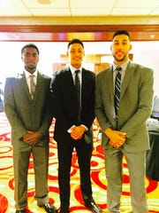 From left: Iowa's Anthony Clemmons, MSU's Bryn Forbes and MSU's Denzel Valentine pose together at this year's Big Ten media day. The trio led Lansing Sexton High School to three state finals appearances and two state titles.