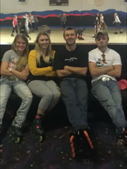 Ashley Hoskins, second on left, with siblings. Now