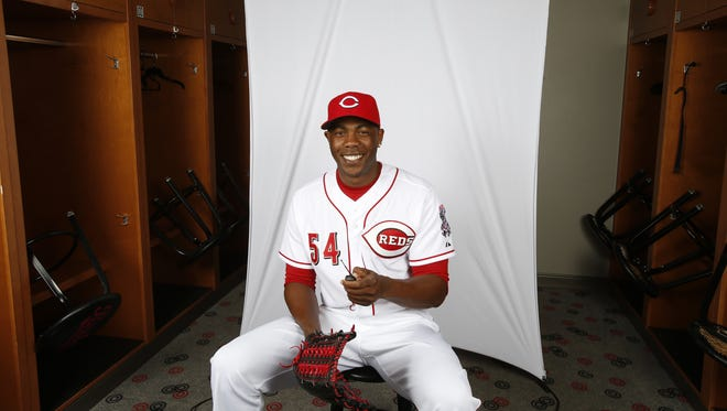 Cincinnati Reds' pitcher Aroldis Chapman takes a photo of himself during picture day.