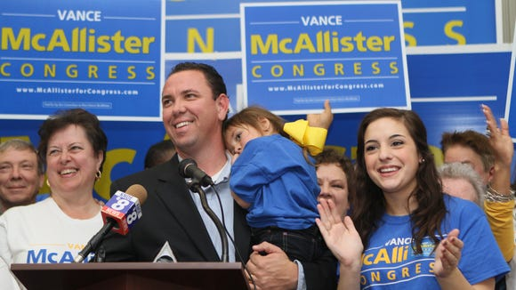 Vance McAllister celebrates with his family and supporters after winning the 5th Congressional District election 60 percent to 40 percent on Saturday, November 16, 2013.