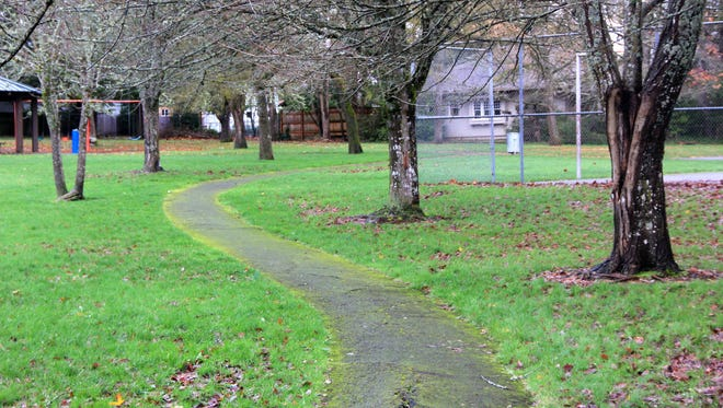 A paved path winds through and around Hillview Park in South Salem.