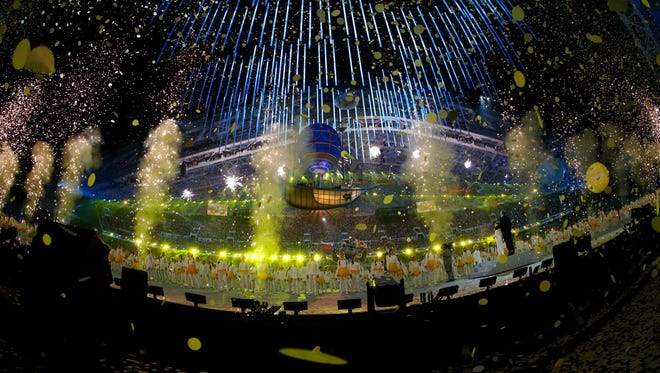 Performers dance during the A New Spring portion of the closing ceremony for the Sochi 2014 Olympic Winter Games at Fisht Olympic Stadium.