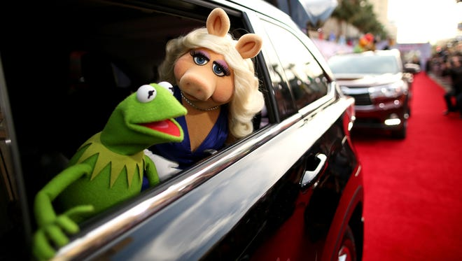 """Kermit the Frog and Miss Piggy arrive at the world premiere of Disney's """"Muppets Most Wanted"""" at the El Capitan Theatre in Hollywood,"""
