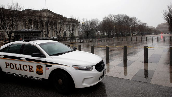Pennsylvania Avenue is closed to pedestrian traffic in front of the White House after a man jumped the White House fence, Sunday.