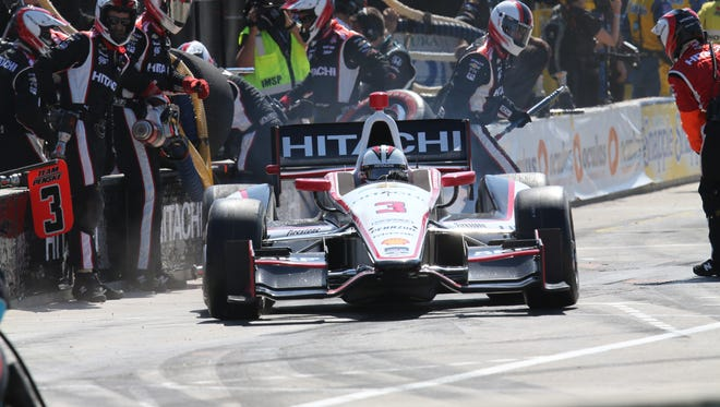Driver Helio Castroneves leaves his pit during the first race of the IndyCar Detroit Grand Prix doubleheader in Detroit, Saturday, May 31, 2014.