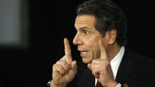 New York Gov. Andrew Cuomo speaks during a news conference on Wednesday, Feb. 12, 2014, in Albany, N.Y.