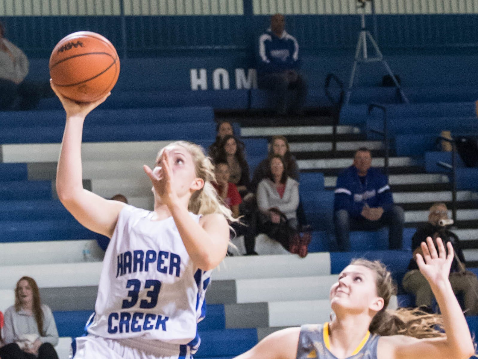 Harper Creek's Olivia Leson goes for the layup during Tuesday's game against St Joseph.