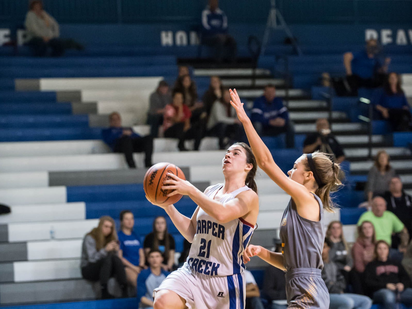 Harper Creek's Jacey Bowers goes for the layup during Tuesday's game against St Joseph.