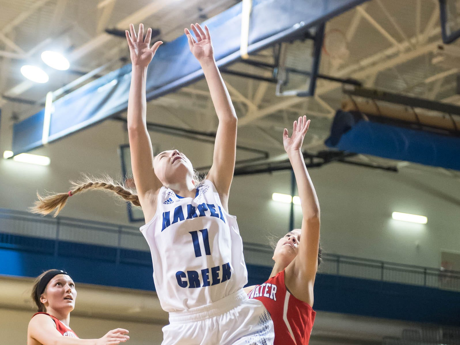 Harper Creek's Macy Hancock takes her shot against Coldwater in Friday evening's game.