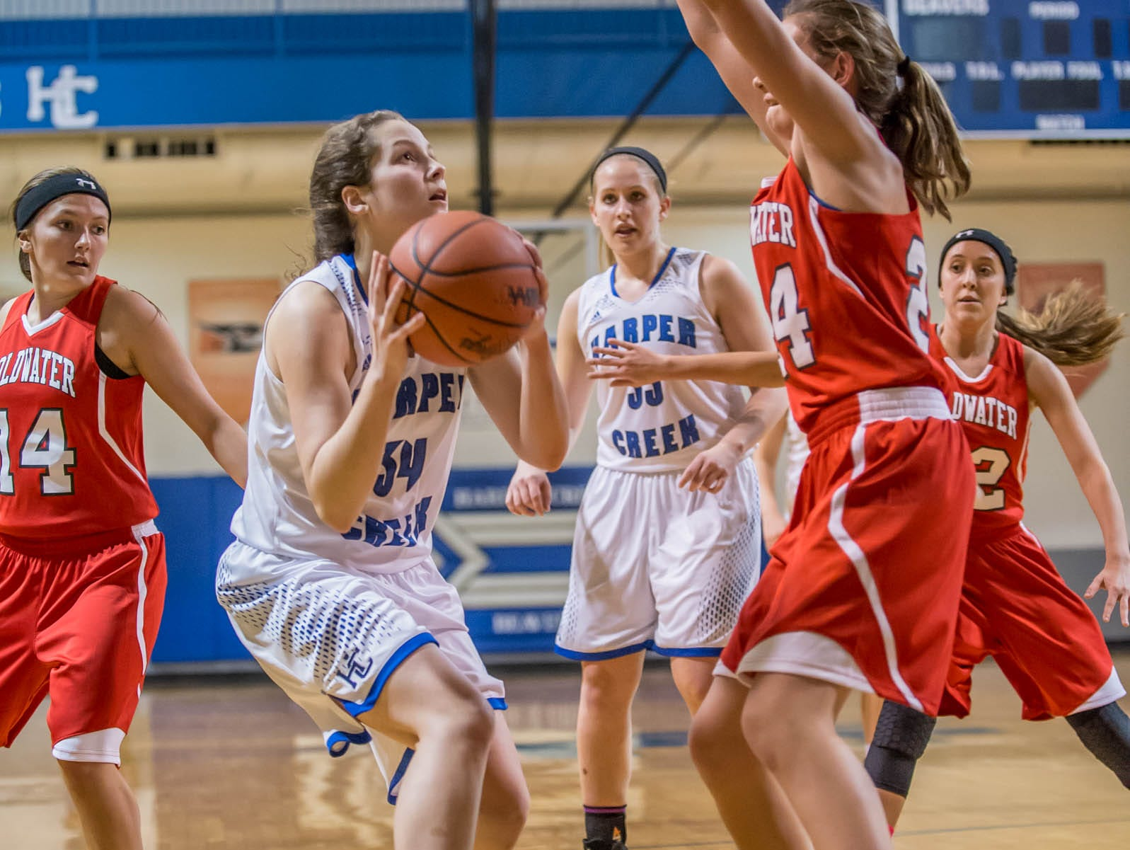 Harper Creek's Faith Hayes takes her shot against Coldwater in Friday evening's game.