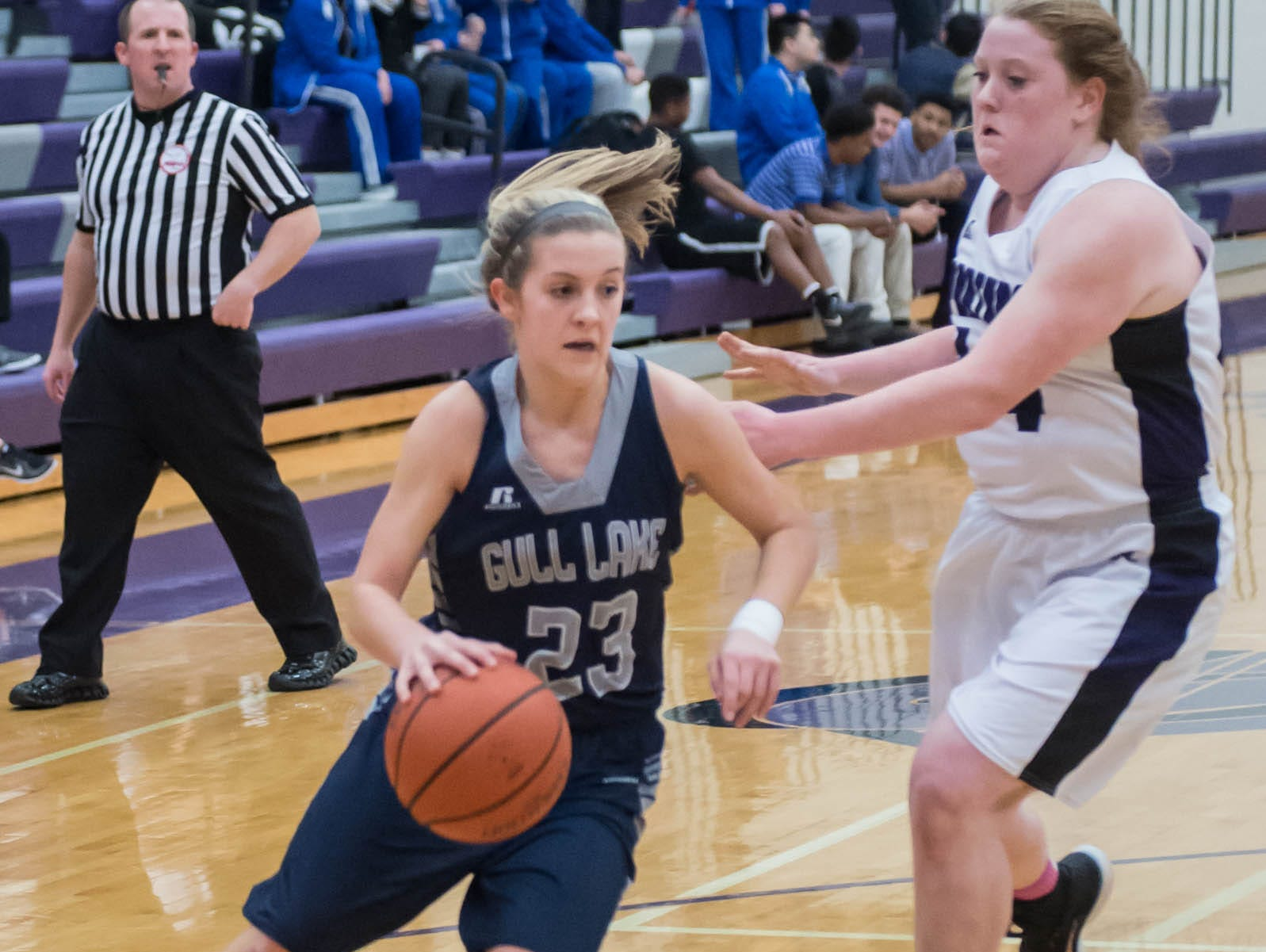 Gull Lakes's Grace Clancy (23) drives to the basket against Lakeview in Friday evening's game.