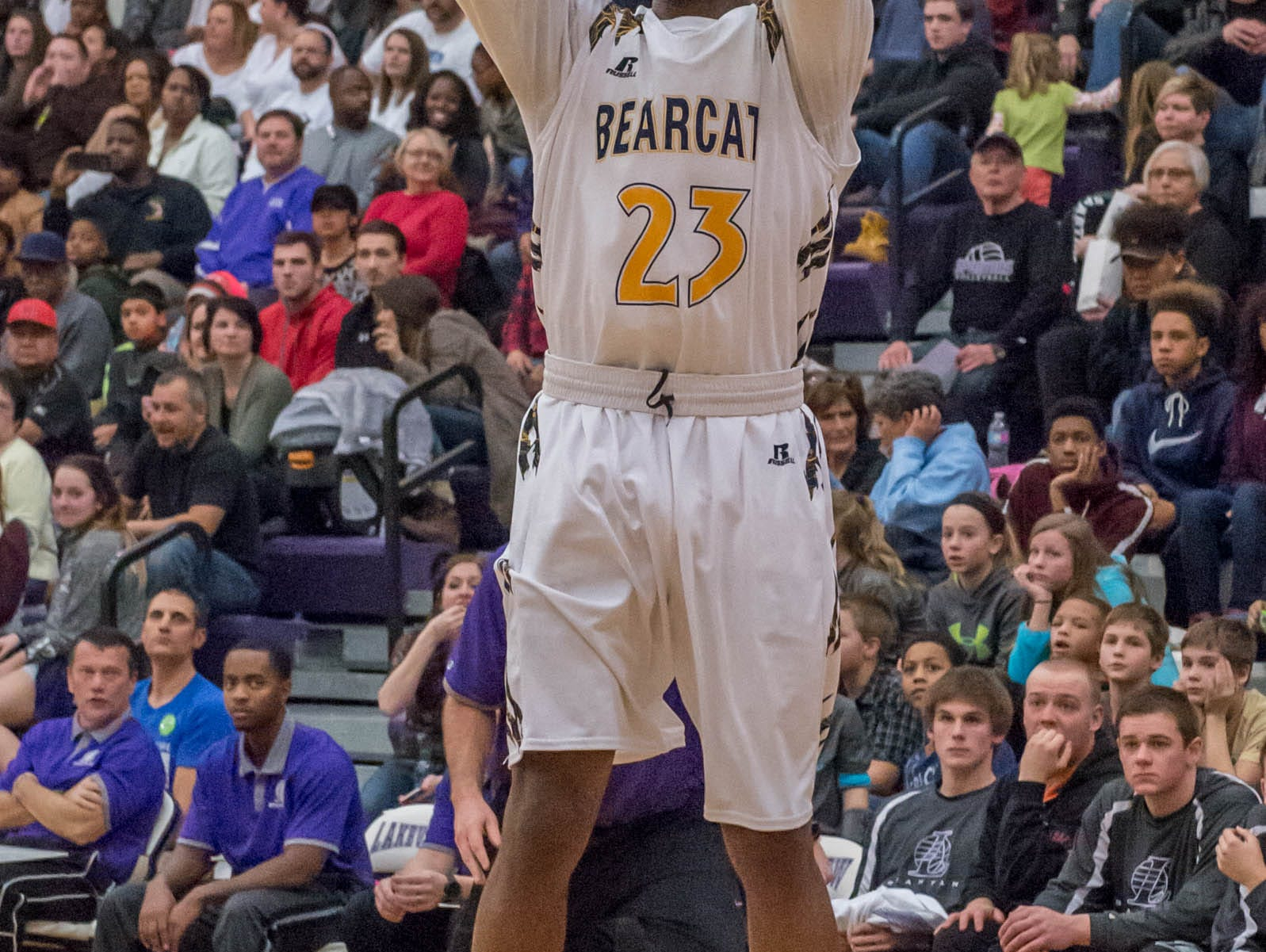 Battle Creek Central's Dontell Hardy (23) take his shot during Friday evening's game.
