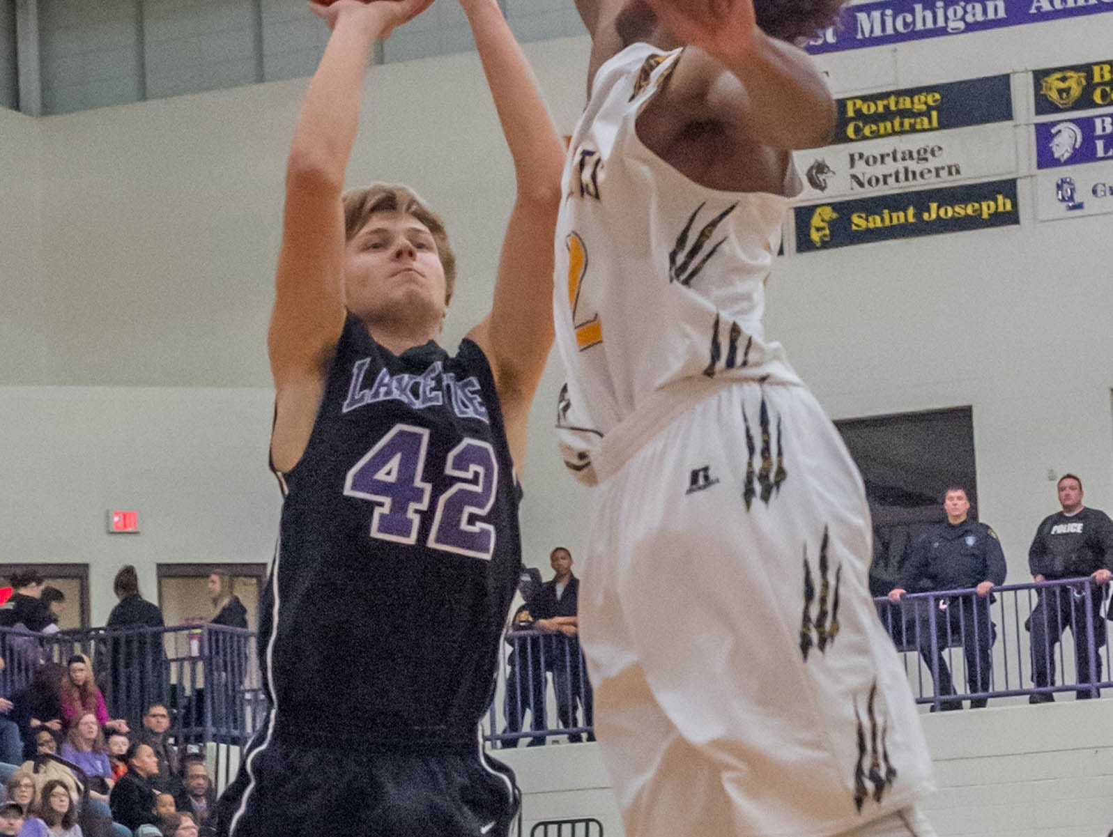 Lakeview's Cameron Hanlon (42) goes for the hoop against Battle Creek Central Friday evening.