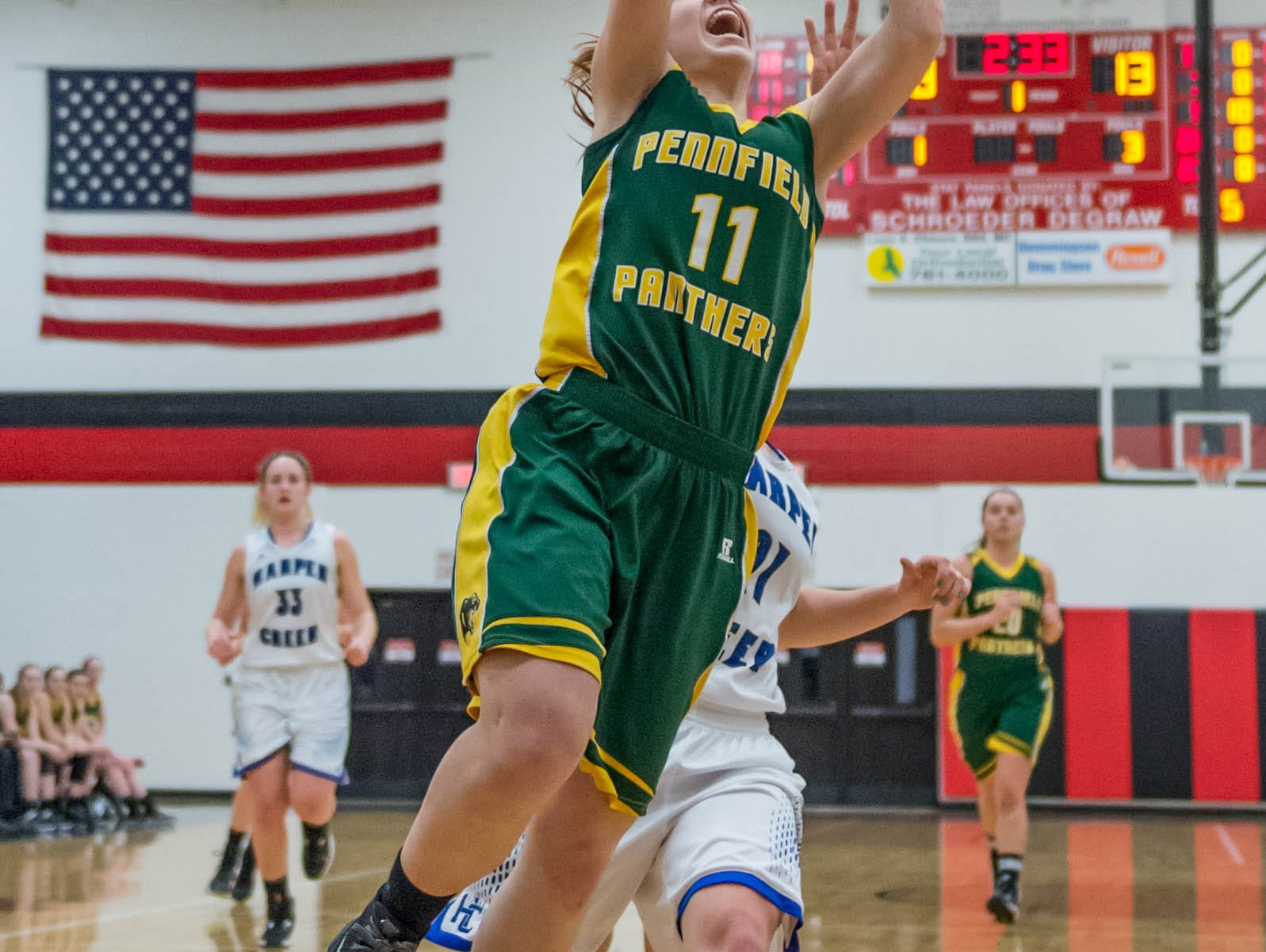 Pennfield's Melanie McIntyre (11) goes for the layup in first round of districts game at Marshall Monday evening.
