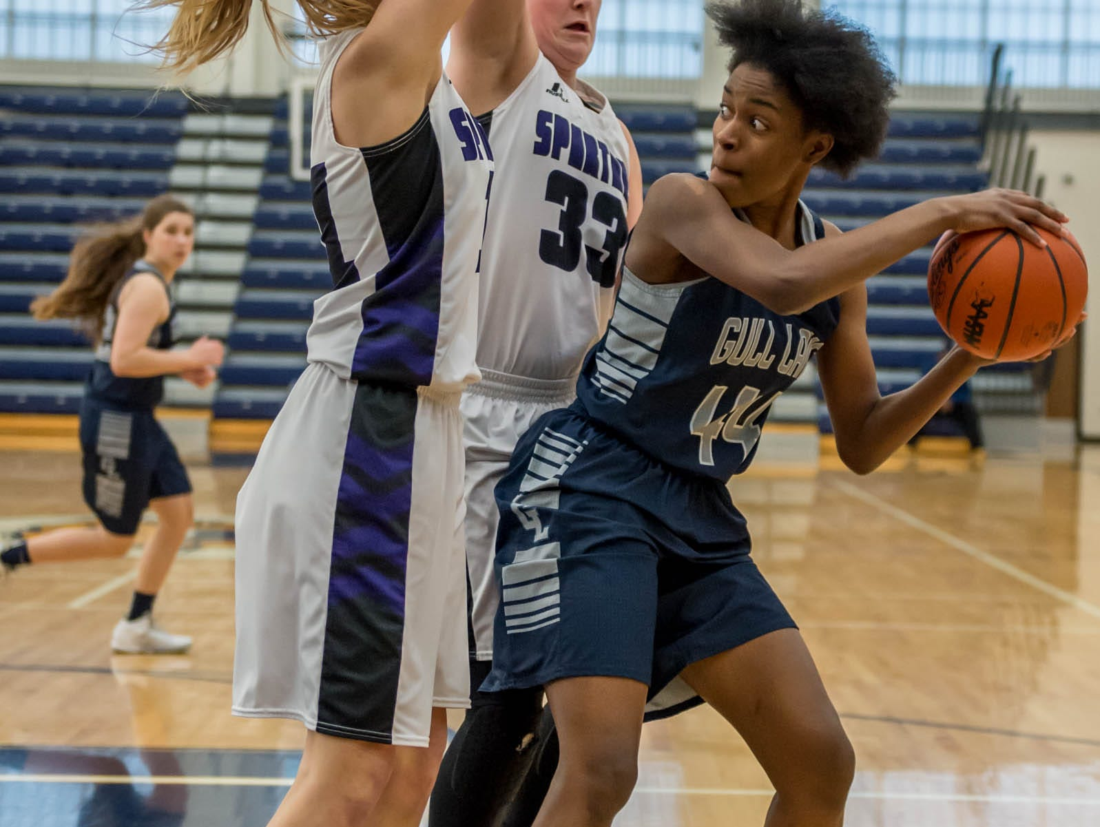 Gull Lake's Imani Morrow (44) looks to pass while being guarded by Lakeview defenders during district game Wednesday evening.