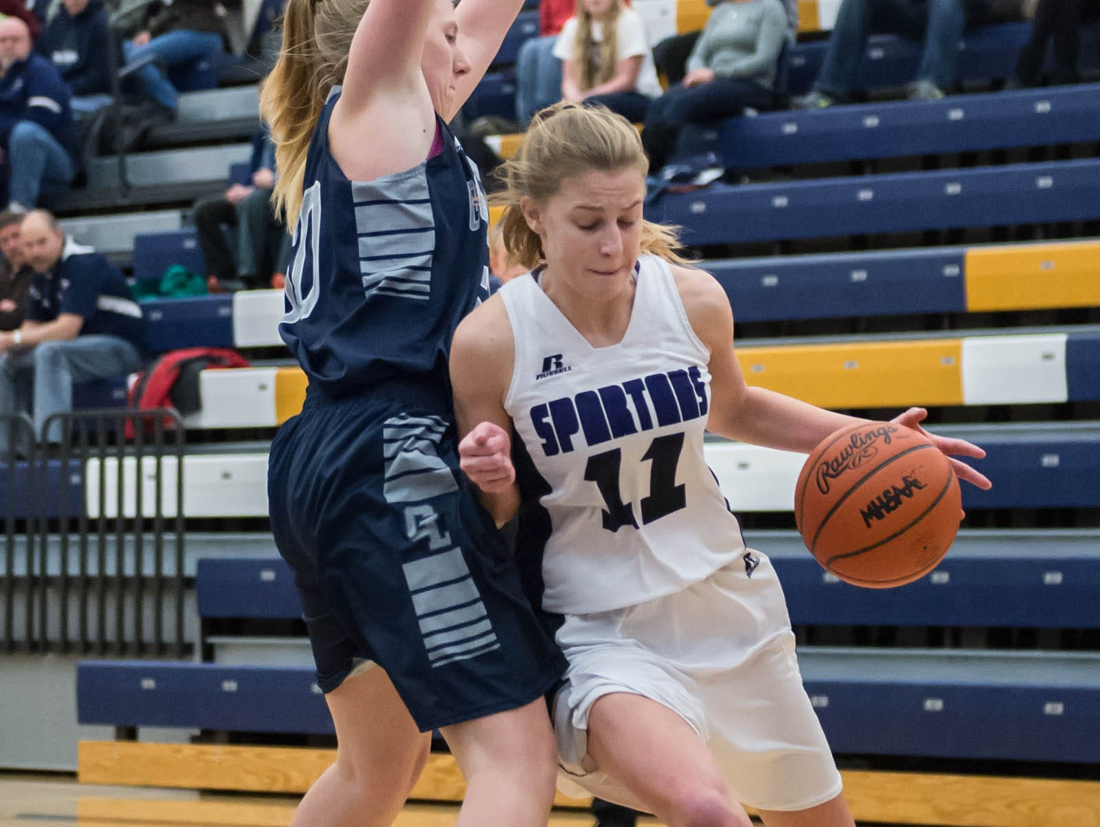 Lakeview's Ava Cook (11) drives to the basket while being guarded by Gull Lake defender Wednesday evening.