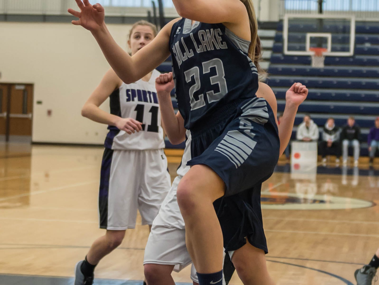 Gull Lake's Grace Clancy (23) goes for the hoop during a district game against Lakeview Wednesday evening.