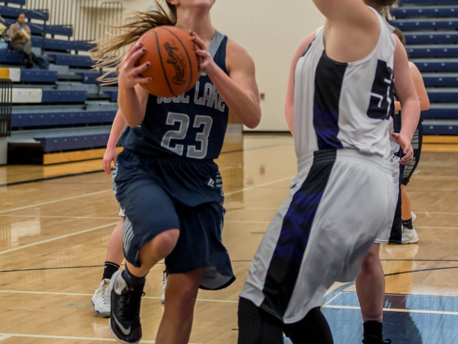 Gull Lake's Grace Clancy (23) goes for the layup during a district game against Lakeview Wednesday evening.