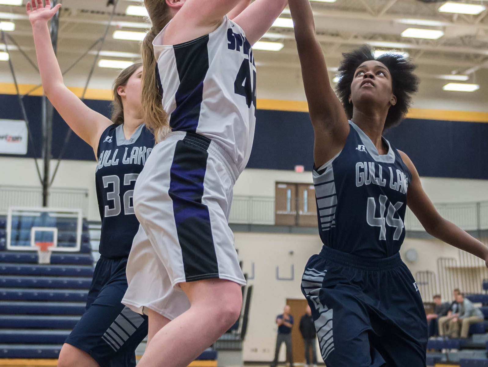 Lakeview's Emily Eldridge (44) goes for the hoop while being guarded by Gull Lake's Imani Morrow (44) Wednesday evening.