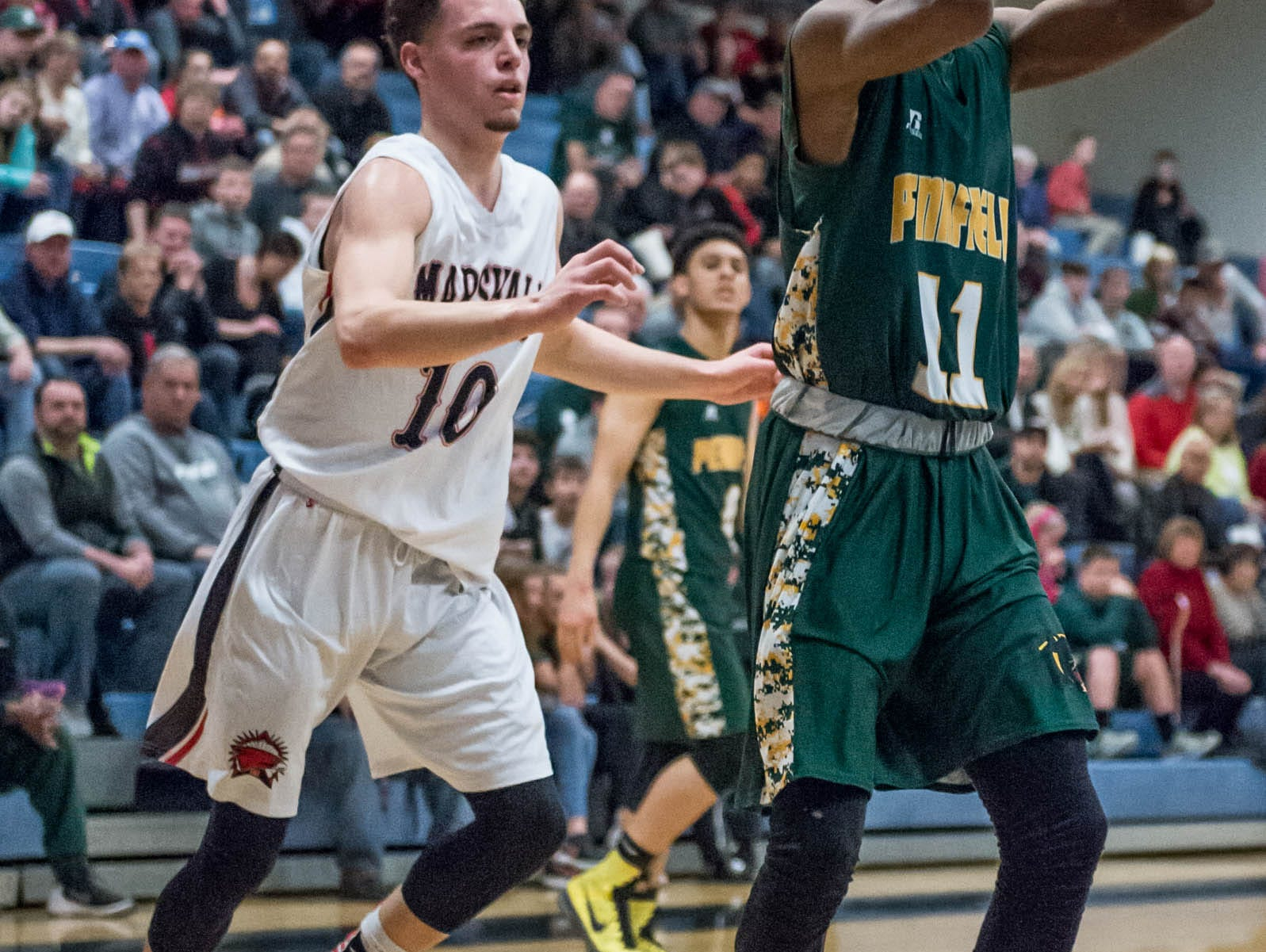 Pennfield's Francois Jamierson (11) goes for the basket during Monday's district game.