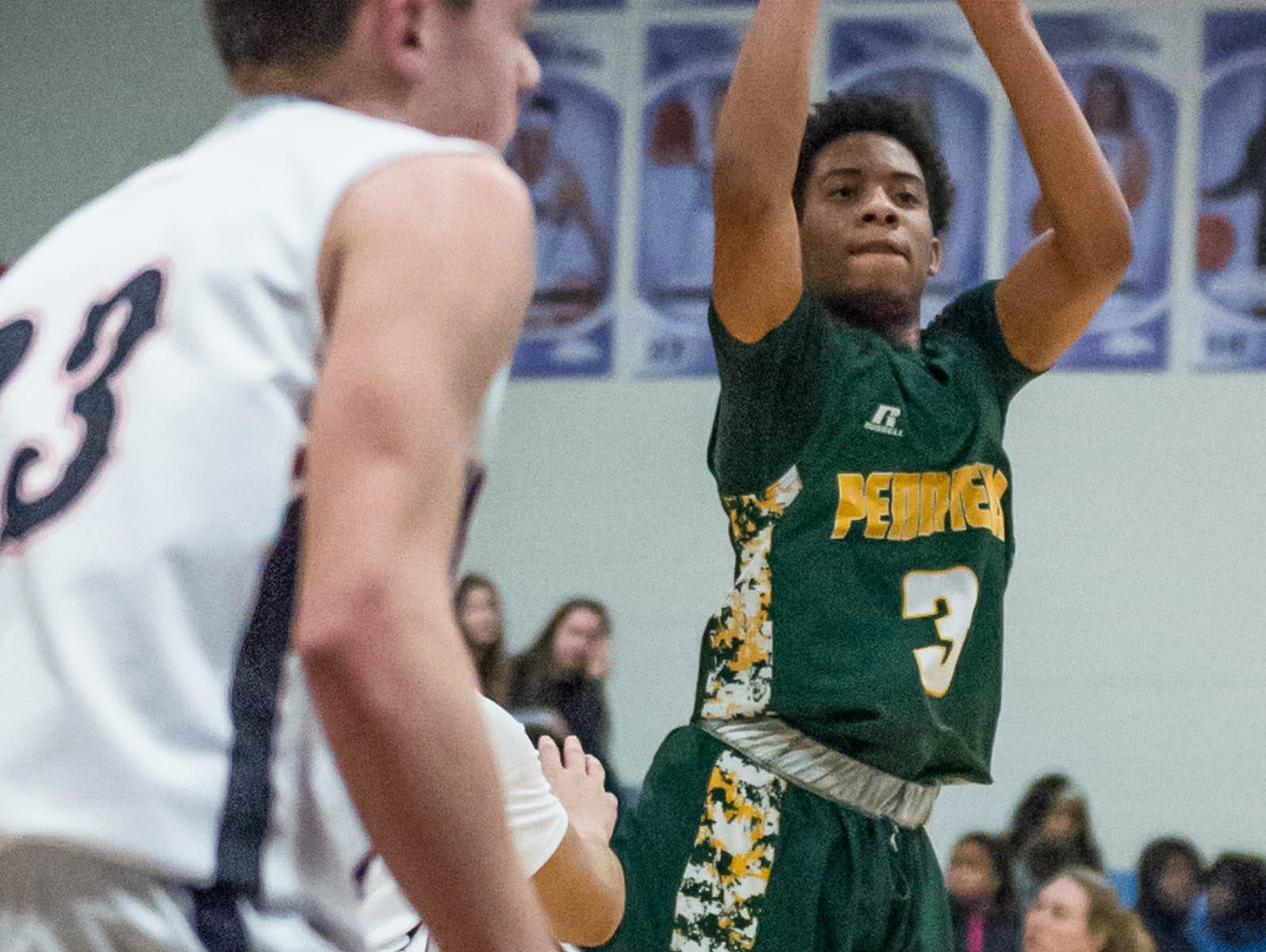 Pennfield's Ronald Jamierson (3) goes for the hoop during Monday's district game.