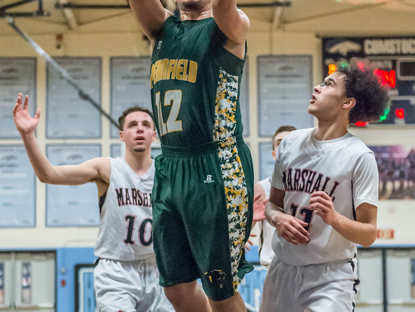 Pennfield's Steffen Kinne (12) goes for the basket during Monday's district game.