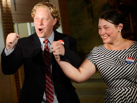 Kevin Schreiber and his wife, Jen, celebrate after Schreiber won a special election for the 95th district state House seat in May 2013.