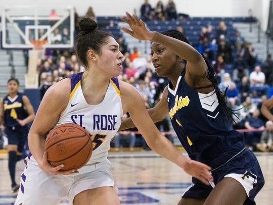 St Rose's Lucy Thomas drives in toward basket against