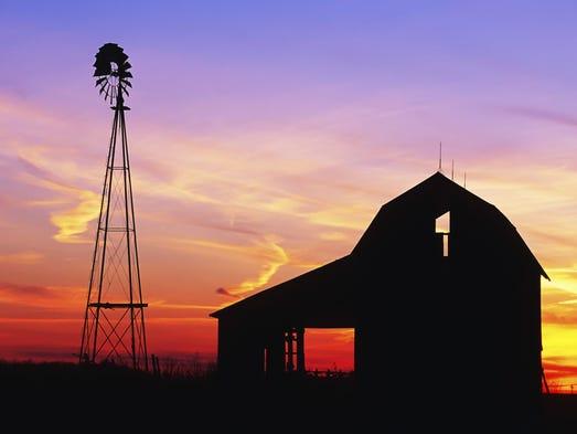 Beautiful windmill and barn at sunset
