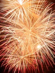 A cluster of fireworks bursts in the sky July 3, 2015,