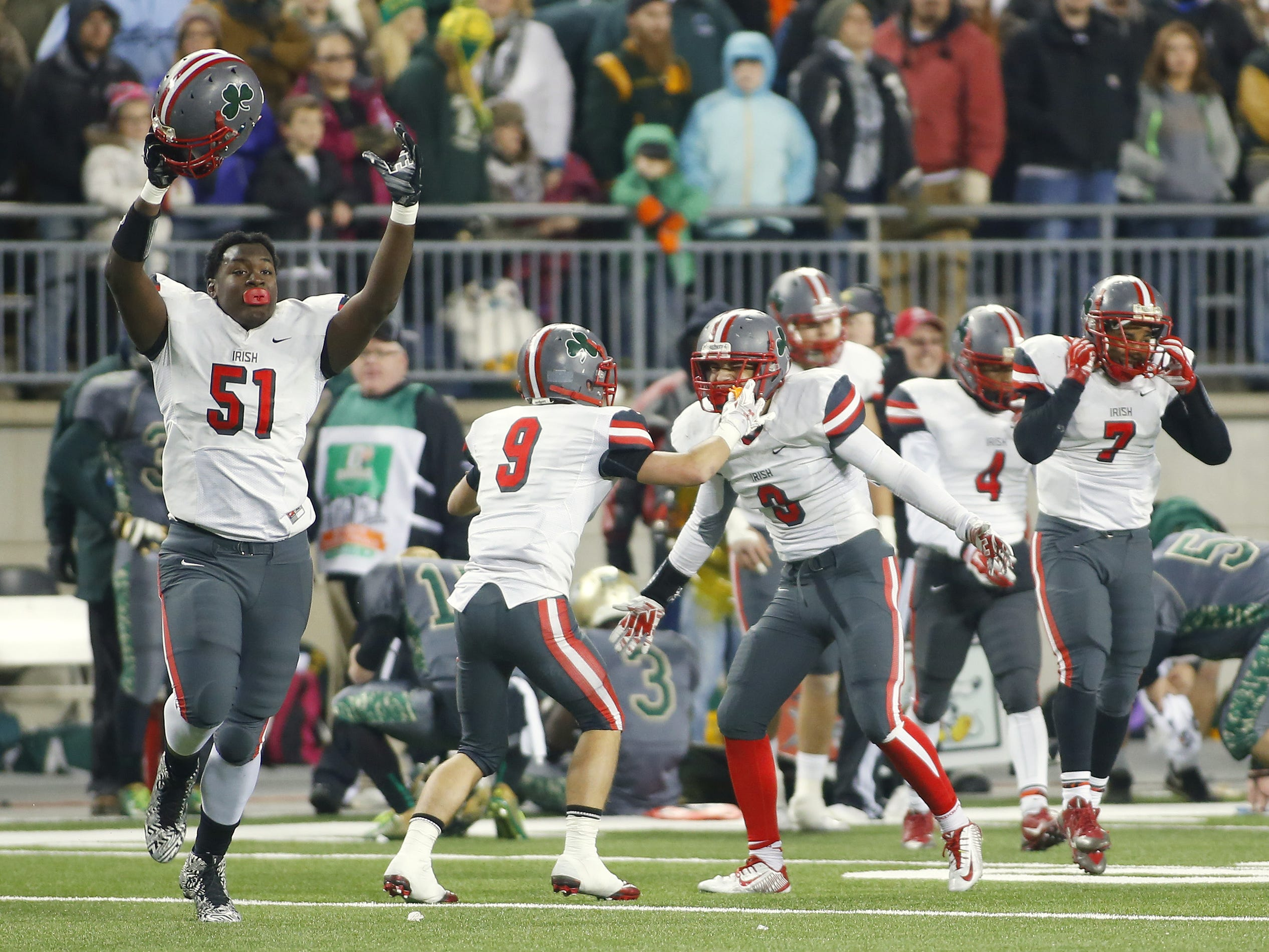 Toledo Central Catholic's James Hudson (51) and teammates celebrate the victory over Athens in the second half of the Ohio high school Division III championship football game at Ohio Stadium.