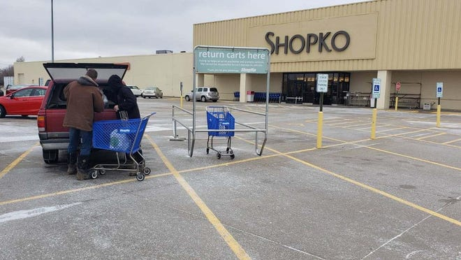 In this file photo, Jim Meyers and his son, Gavin, of Cameron, put away their purchases at Shopko. The Monmouth Shopko closed in May 2019. Now, the city of Monmouth is hoping to find new life for empty buildings and attract new businesses with the creation of sweeping new Tax Increment Financing and Business Development districts.