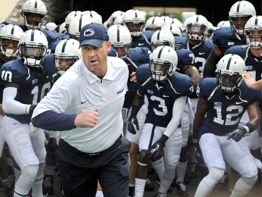 Bill O'Brien leads the Penn State football team onto the field for their first game of the season against Ohio on Saturday, Sept. 1, 2012.