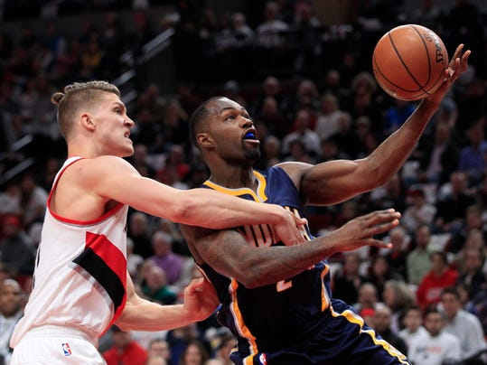 Indiana Pacers guard Rodney Stuckey, right, gets fouled by Portland Trail Blazers forward Meyers Leonard during the first half of an NBA basketball game in Portland, Ore., Wednesday, Nov. 30, 2016. (AP Photo/Steve Dipaola)