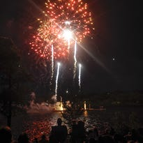 People gathered to watch the fireworks on the Mississippi River at Hester Park.