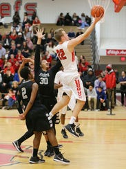 Going in for a layup Friday night is Canton's Greg
