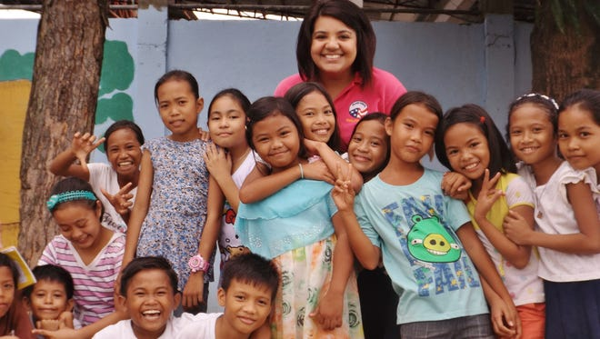 Sarina Ufi with her students in the Philippines.
