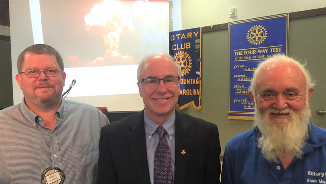 Major General Richard T. Devereaux, USAF retired, is flanked by (on left) Roger Kumpf, Black Mountain Rotary Club president-elect, and Sam Hobson, club president.