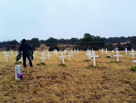 laying of wreaths in rain