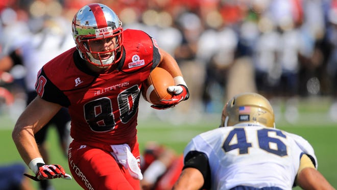 Western Kentucky tight end Mitchell Henry (80) carries the ball for extra yards during a 2013 game against Navy.