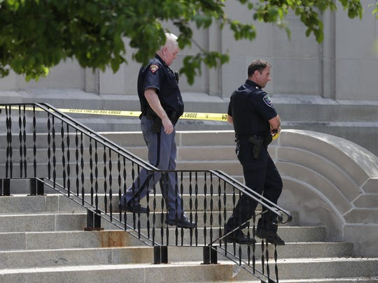 Police rope off the entrance to the Outagamie County Administrative Building along South Walnut Street after a suspicious briefcase was found on the sidewalk Tuesday.