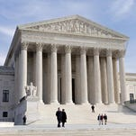 """The Supreme Court affirmed the principle of """"one person, one vote"""" Monday with a unanimous decision supporting drawing legislative district lines based on total population."""