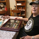 Warren Musaus, 95, is one of two men who will receive the Lance Sijan Award from the Milwaukee Armed Forces Week Committee. Museus served with the Army 101st Airborne Division aboard a glider during the invasion of Normandy. He was photographed at home in Menomonee Falls with the medals, service awards and uniform insignia.