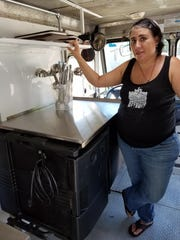 Karen Kahn Schultz shows the inside of her food truck,