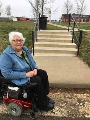 Jan White has to use her wheelchair in the roadway at Rutledge-Wilson Park because the nearby sidewalk has about a 7-inch drop.