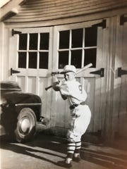 Bill Stephenson models his Little League batting stance.