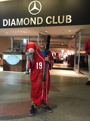 Walter Herbert poses with the jersey Joey Votto game him. He is suffering from Stage 4 neuroblastoma, one of the most common types of pediatric cancer.