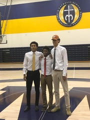 Pictured left to right, Jeremiah Davenport (Basketball,